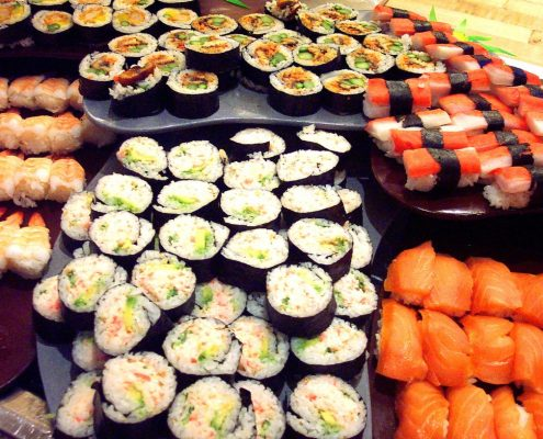 variety of sushi rolls on a platter. Fresh fish is good for the heart.