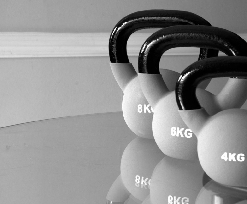 kettle bells on a glass surface