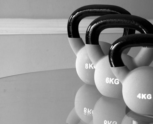 kettle bells in a line