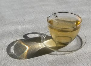 a glass cup of green tea